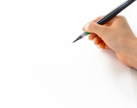 はがきを書こうとしている画像